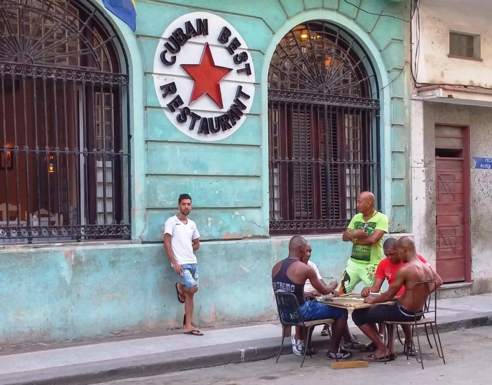 Cuban men play dominoes photo by Jenifer Joy Madden