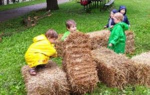 Kids play with straw bales