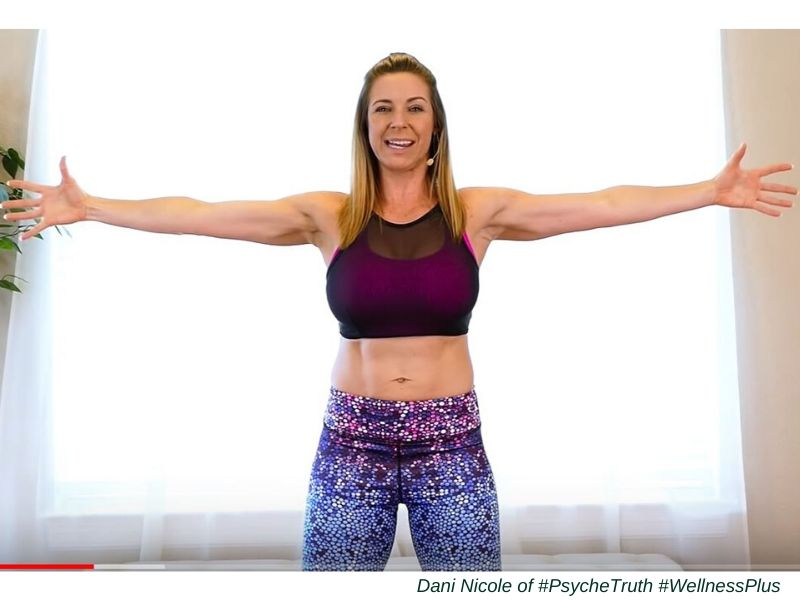 Fitness instructor with outstretched arms