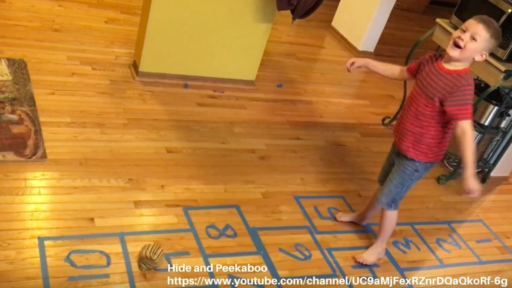 Child plays hopscotch in the kitchen