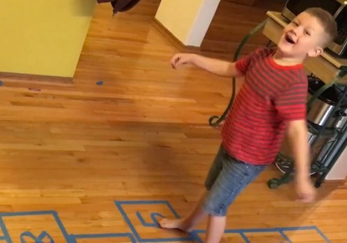 CHild plays indoor hopscotch