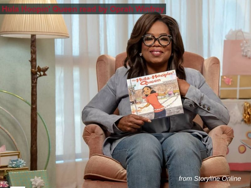 Oprah Winfrey is seated holding a children's book