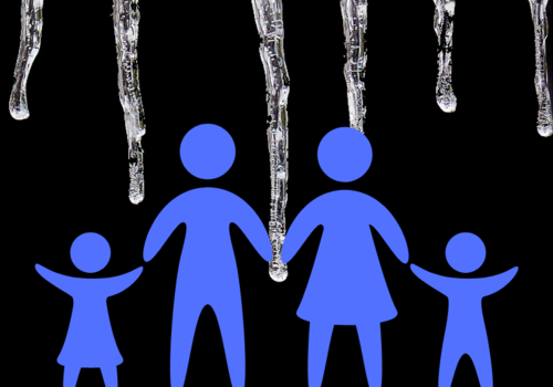 Family of two parents and two kids confront large icesicles