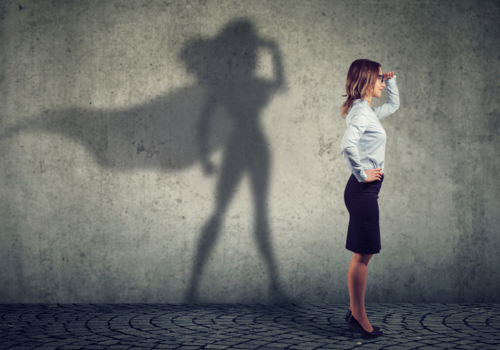 To explain concept of a durable human being, image is of woman in business attire standing in front of a shadow of a superwoman